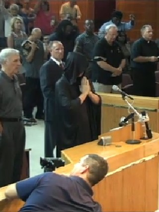 Satanic Prayer At Council Meeting Disrupted By Crowd Wear