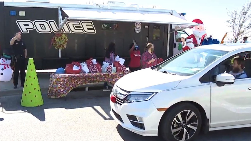 Pensacola police spread Christmas joy with drive thru toy giveaway